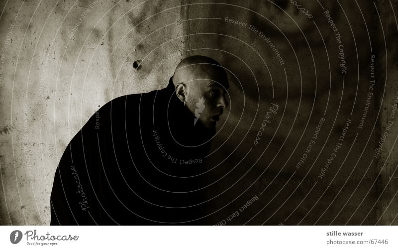 Human being Man Dark Fear Concrete Facial expression Obscure Bald or shaved head Coat Panic Equal Vampire Bell-ringer
