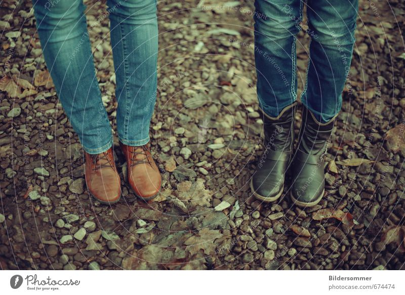 Human being Woman Youth (Young adults) Blue Relaxation 18 - 30 years Adults Feminine Stone Legs Brown Couple Friendship Earth Stand Hiking