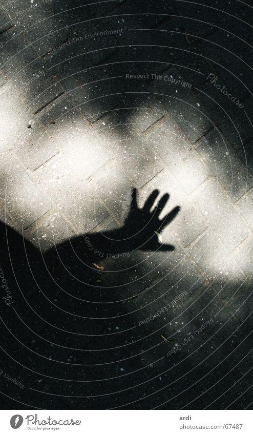 Hand Sun Street Dark Lanes & trails Arm Fingers Floor covering Creepy Cobblestones Ghosts & Spectres  Door handle Paving stone Detective novel Terror Thriller