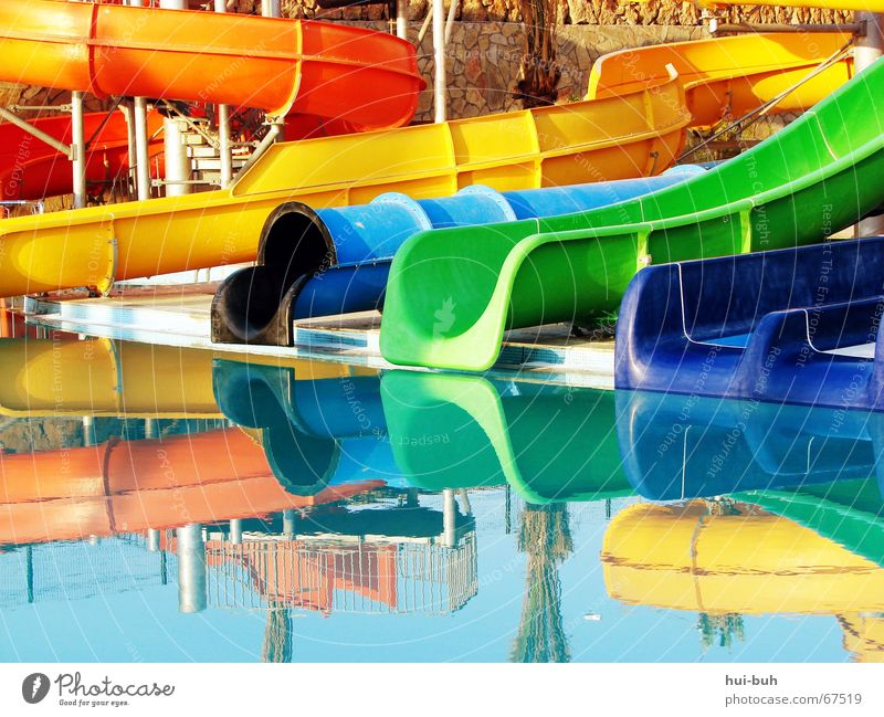 colorful-wirr-warr Reflection Yellow Green Vacation & Travel Long Swimming pool Leisure and hobbies Desire Slide slides Blue black fun Joy Orange End Beginning