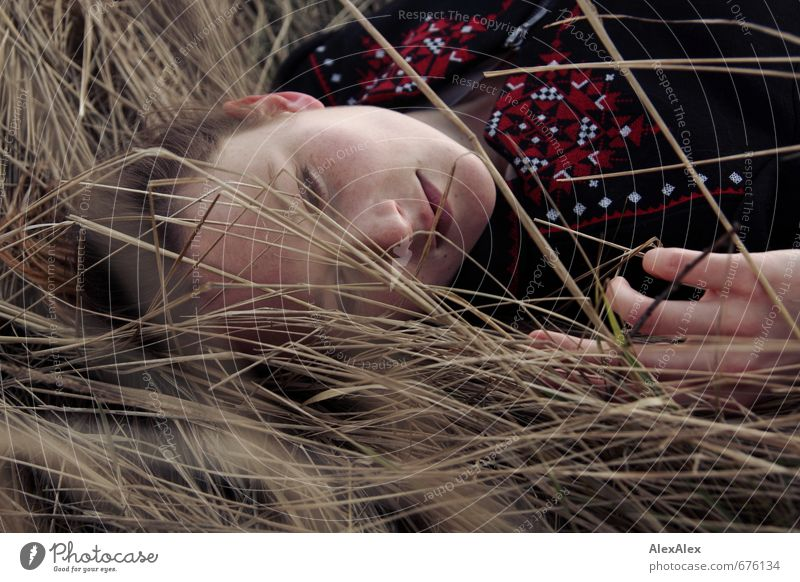Portrait lying down Young woman Youth (Young adults) Face Hand 18 - 30 years Adults Grass Bushes Jacket Brunette Long-haired Freckles Observe Lie Looking Dream
