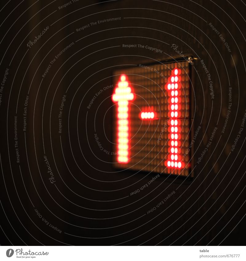 further up . . . Building Elevator Metal Plastic Sign Characters Digits and numbers Signs and labeling Line Arrow Driving Glittering Illuminate Dark Bright Red
