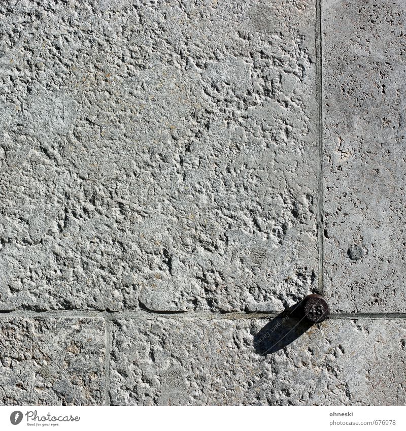 48 Manmade structures Building Wall (barrier) Wall (building) Facade Stone Digits and numbers Gray Seam Colour photo Subdued colour Exterior shot Abstract