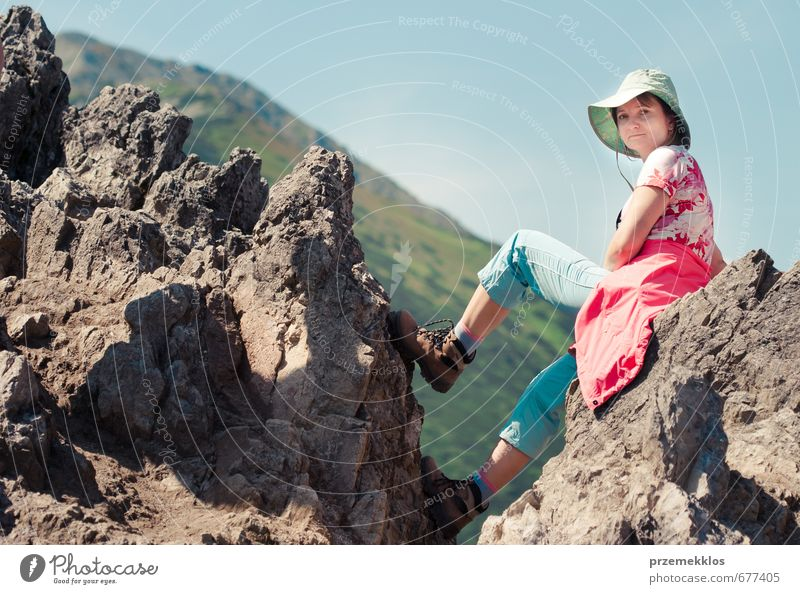 Woman sitting on mountain peak Human being Sky Nature Youth (Young adults) Vacation & Travel Blue Summer Relaxation Landscape Joy Adults Mountain Sports Stone