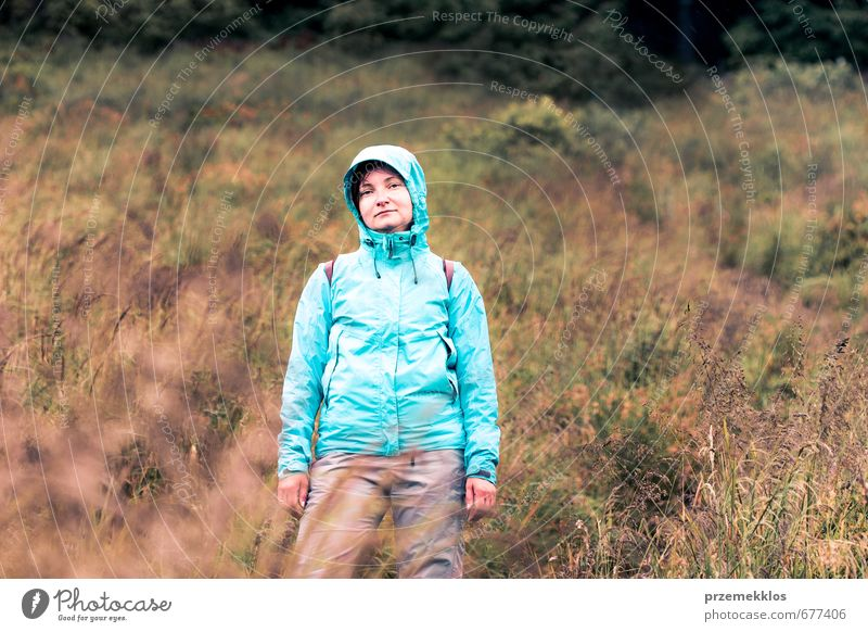 Woman standing on grassy slope Vacation & Travel Trip Mountain Hiking Climbing Mountaineering Adults 1 Human being 30 - 45 years Nature Landscape Grass Jacket