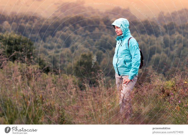 Woman taking a rest on mountain trail Human being Nature Youth (Young adults) Vacation & Travel Tree Landscape Adults Mountain Grass Together Fog Stand Hiking