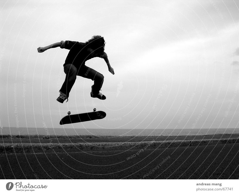 Kickflip by the sea Skateboarding Salto Jump Ocean Curbside Style Trick Action Sports Extreme Flying Tasty Parking level Boy (child) boy Street road Coil roll