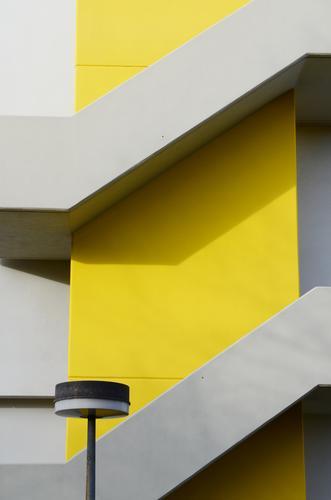 Yellow staircase Design High-rise Stairs Concrete Illuminate Cool (slang) Town Gray Modern Lamp Street lighting Exploit Vertical Diagonal Facade up down