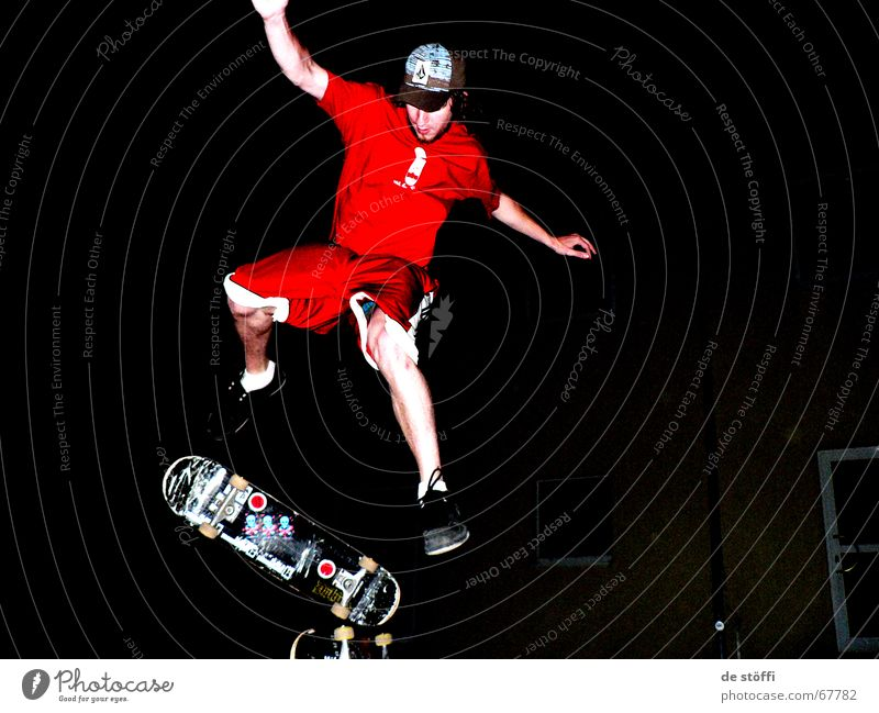 nocturnal active Skateboarding Red Baseball cap Cape Dark Action Jump Fellow Young man Label Night Clothing in midair Legs Musculature Rotate Tall move yeah Joy