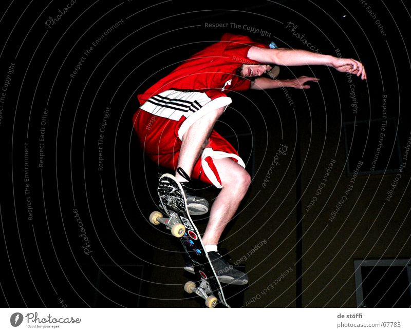 put.your.hands.up.in.the.air. Skateboarding Red Cape Dark Action Jump Fellow Young man Label Night Concentrate Clothing in midair Legs Musculature Rotate Tall