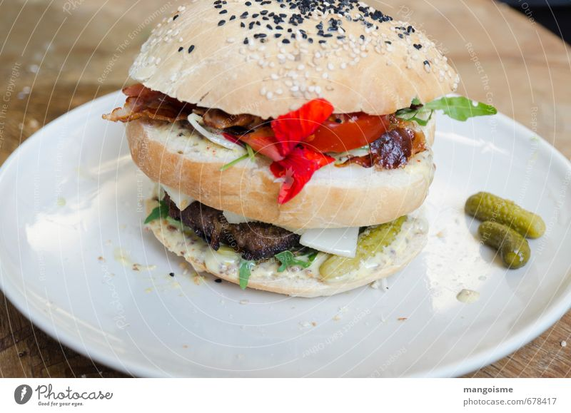 hamburger round piece warm. Meat Lettuce Salad Roll Tomato Hamburger Goat`s cheese Gherkin Sesame Meat loaf Nutrition Organic produce Vegetarian diet Fast food