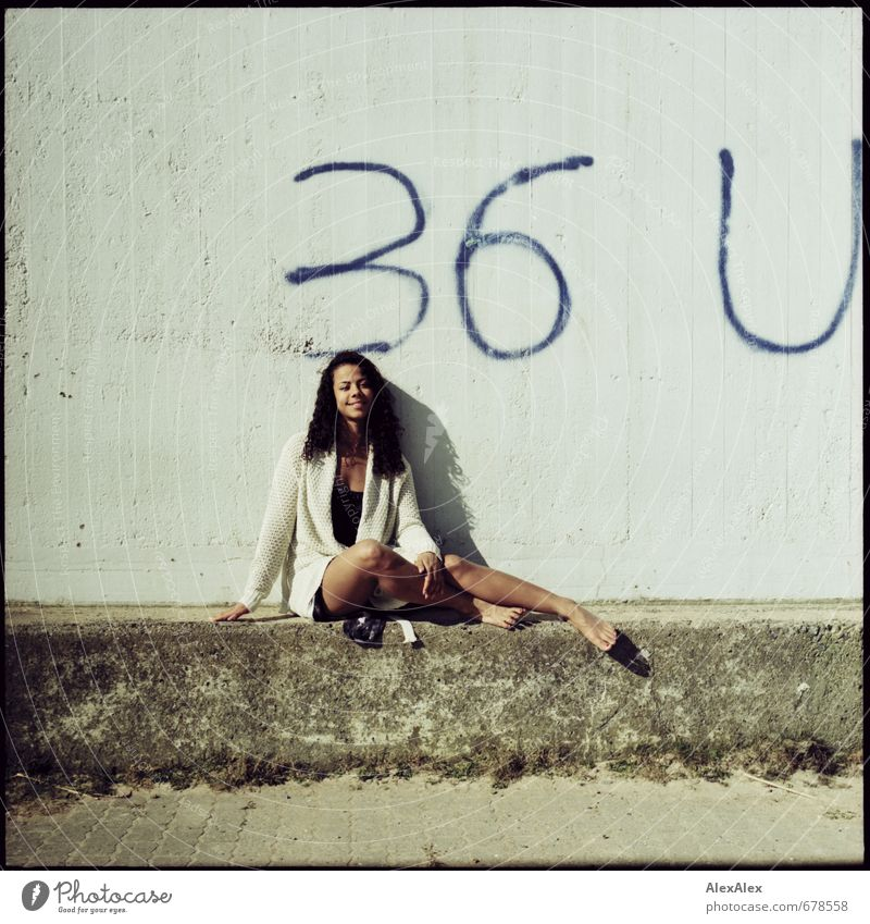Summer day in March Trip Young woman Youth (Young adults) Head Legs 18 - 30 years Adults Beautiful weather Concrete wall 36 Graffiti Cardigan Barefoot