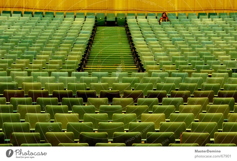 Woman Green Loneliness Wall (building) Sit Empty Stairs Film industry Lady Theatre Cinema Past Seating Armchair Row of seats Scarf