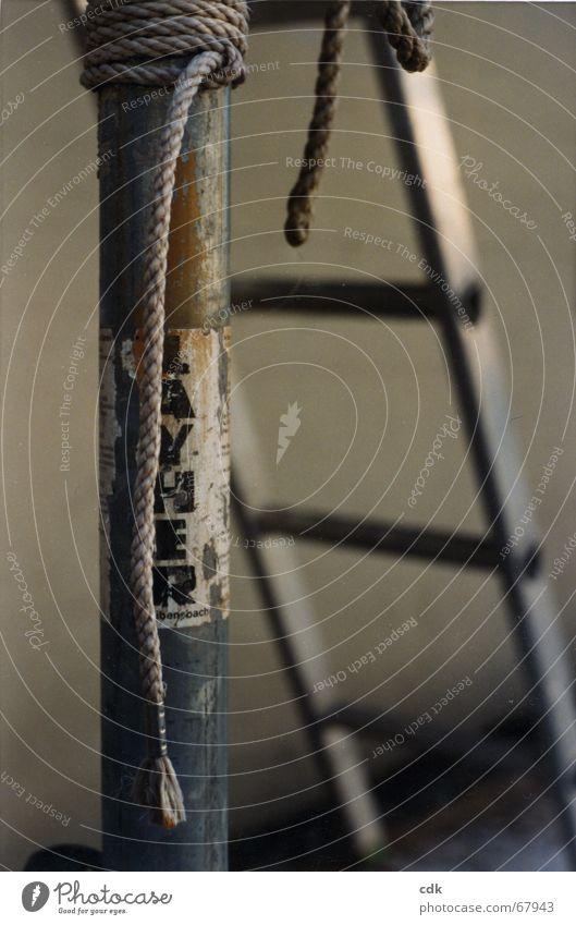 temporise Handbill Assault Information Worn out Attach Stick Repair Lean Hang Still Life Deserted Blur Gray Silver Dark Pole Ladder Rope Advertising