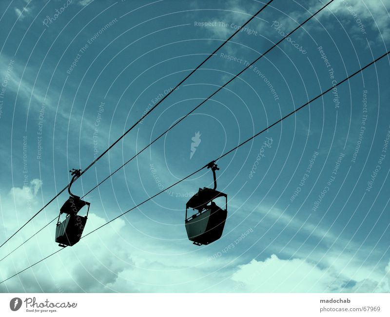 RACE IN BLUE Suspension railway Cable car Clouds Sky Trip Direction Beautiful weather Gondola 2 In pairs Isolated Image Bright background Clouds in the sky