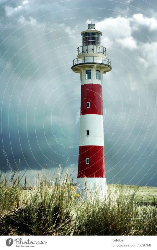 Lighthouse in bright sunbeams before approaching thunderstorm Thunder and lightning Sunbeam Storm clouds Manmade structures built Deserted Architecture