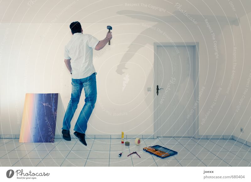 Man attaching a hanger for picture Redecorate Arrange Hammer Masculine Adults 1 Human being Wall (barrier) Wall (building) door Work and employment
