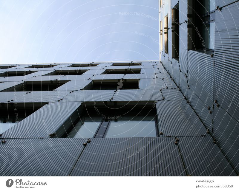 on the edge of architecture Office building Facade Building Window Vanishing point Worm's-eye view Symmetry Concrete Steel Corner Manmade structures Part