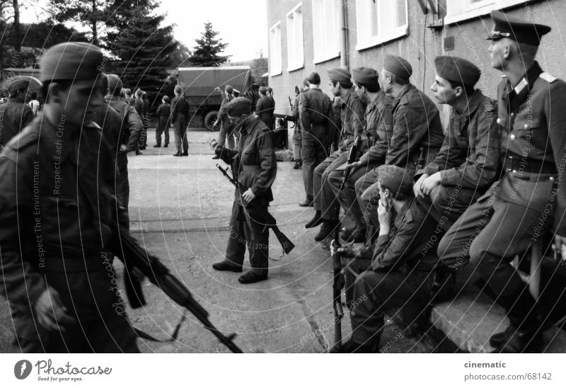 Standing still Uniform Extra Soldier Man Weapon Boots East Border Building Window Snapshot Human being Border area Wait GDR Photography Germany Window pane