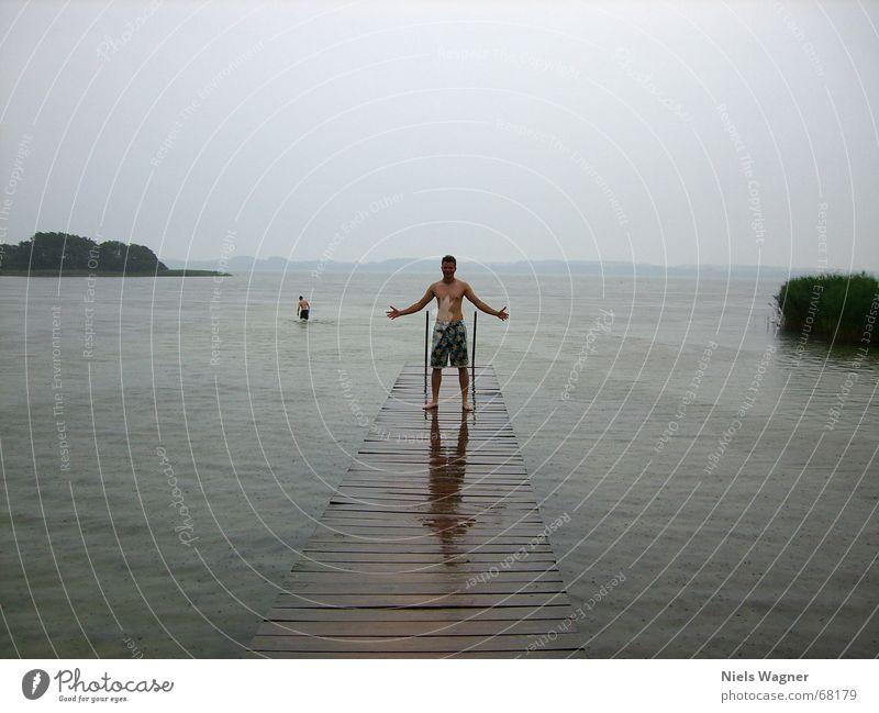 Human being Water Clouds Cold Gray Lake Rain Wet Footbridge Bad weather