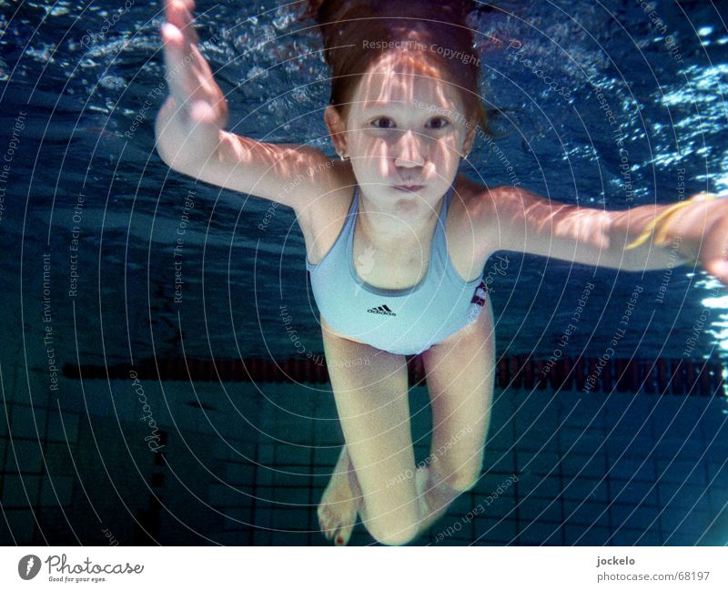 dive Swimming pool Swimming & Bathing Playing Sports Dive Child Blue Swimsuit hold one's breath Nirvana canon yomam Colour photo Underwater photo