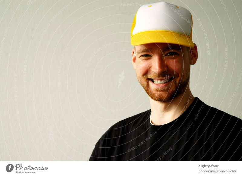 White Wall (building) Laughter Head T-shirt Facial hair Hat Grinning Baseball cap