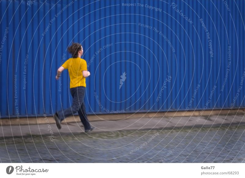 Yellow shirt Wall (building) Running Walking T-shirt Blue Industrial Photography Street Contrast Human being