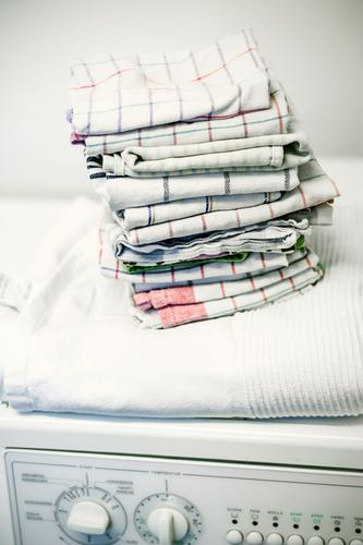 Cooking and coloured laundry Flat (apartment) Bathroom Washer Laundry Towel Cleaning Orderliness Cleanliness Arrangement Tidy up Washing day Folded Colour photo