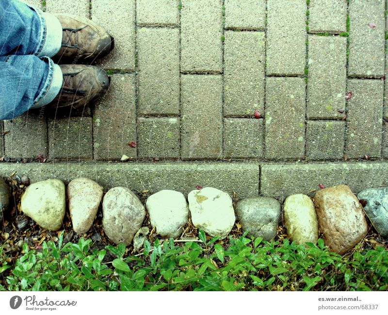 Human being Loneliness Colour Lanes & trails Stone Sadness Feet Footwear Dirty Stand To go for a walk Jeans Sidewalk Tile Student Minerals