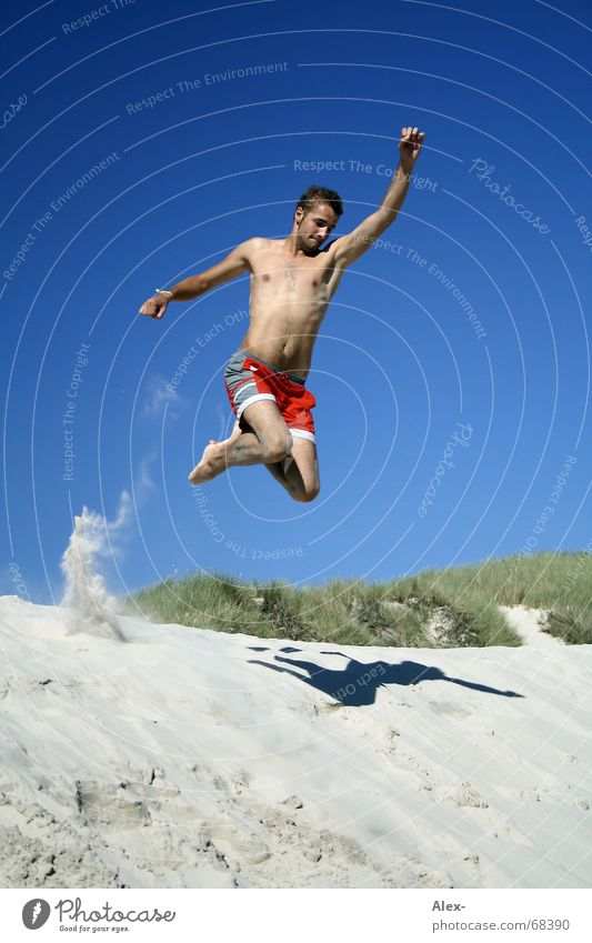 Man Youth (Young adults) Sky Ocean Summer Beach Vacation & Travel Jump Sand Flying To fall Beach dune Superman Swimming trunks Hero