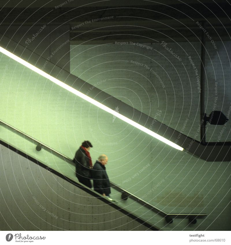 downwards Human being Wall (barrier) Wall (building) Underground Escalator Concrete Movement Green Station Lighting Underpass Downward In transit Traveling