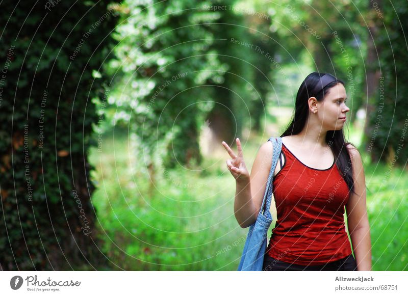 Peace! Avenue Green Woman Happiness Peace-loving Tree Forest Exterior shot Portrait photograph Human being looks to the right two fingers red shirt Nature