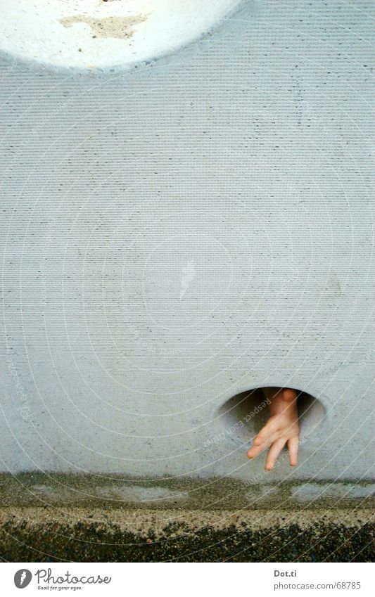 Human being Child Hand Joy Wall (building) Playing Gray Wall (barrier) Sand Fear Small Search Concrete Fingers Gloomy Threat
