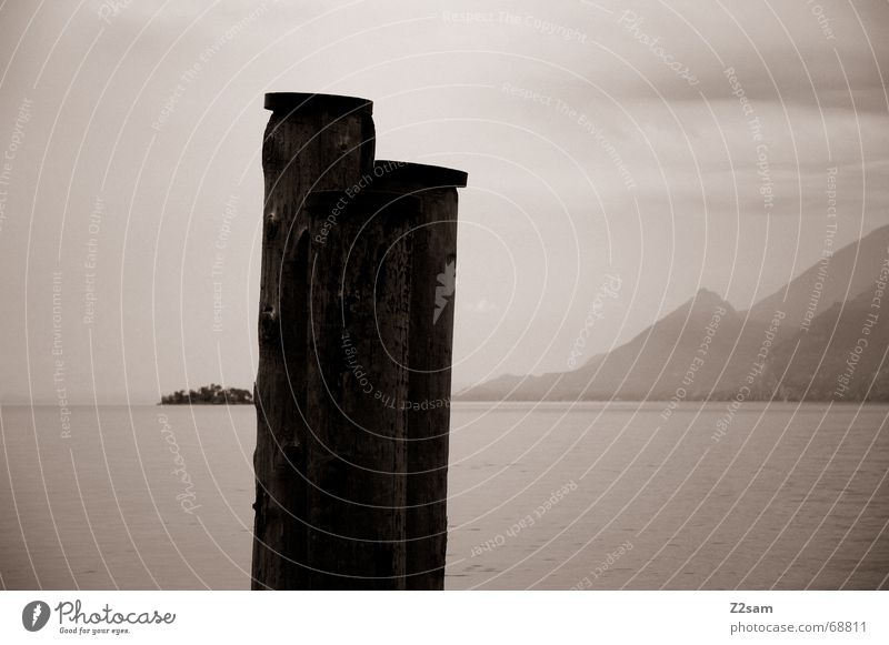 arrival Lake Wood Loneliness Calm Comforting Wood flour Garda Harbour Pole Tree trunk Evening Far-off places
