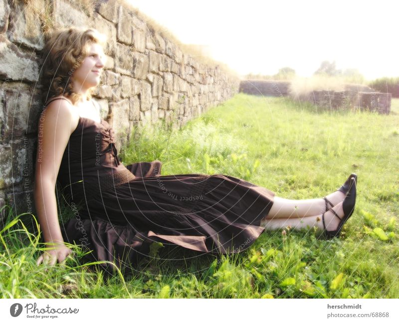 Woman Sky Hand Green Black Grass Hair and hairstyles Happy Stone Laughter Wall (barrier) Bright Feet Brown Footwear Happiness