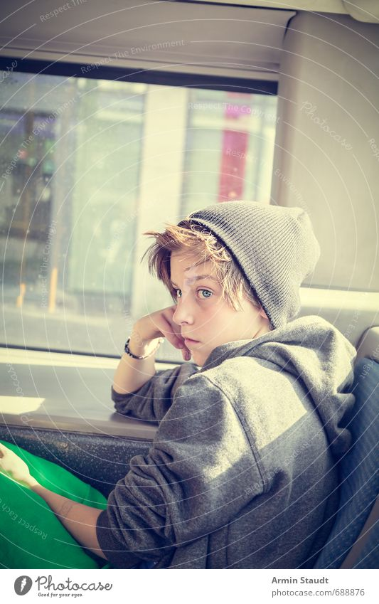 Portrait in the bus Trip Human being Masculine Youth (Young adults) 1 8 - 13 years Child Infancy Rush hour Bus Hooded sweater Cap Observe Sit Dream Sadness