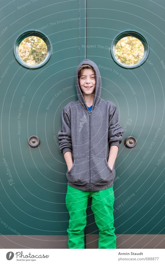 Portrait in front of the porthole door Style Human being Masculine Youth (Young adults) 1 8 - 13 years Child Infancy Wall (barrier) Wall (building) Window Door