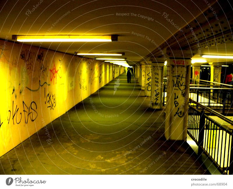 way to the vanishing point Yellow Underground Lamp Oppressive graffiti Berlin Column Lanes & trails Human being Corridor