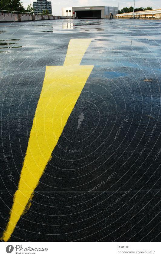 Yellow Wet Arrow Direction Garage Puddle Parking garage Tar