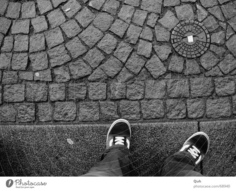 "standing waiting wishing Footwear Sidewalk Gully Chewing gum Curbside Pants Boredom Wet Cobblestones """"w"""" Legs Feet Wait Rain Paving stone"
