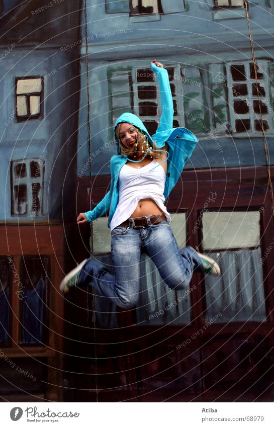 Woman Blue House (Residential Structure) Jump Window Happy Laughter Building Blonde Flying To fall Scream Hop Facial expression Emotions