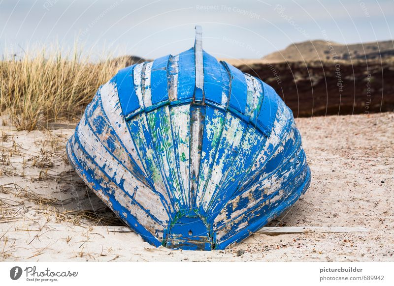 Blue boat keel top Nature Landscape Sand Beach North Sea Ocean Deserted Navigation Rowboat Wood Calm Loneliness Stagnating Sylt Colour photo Exterior shot