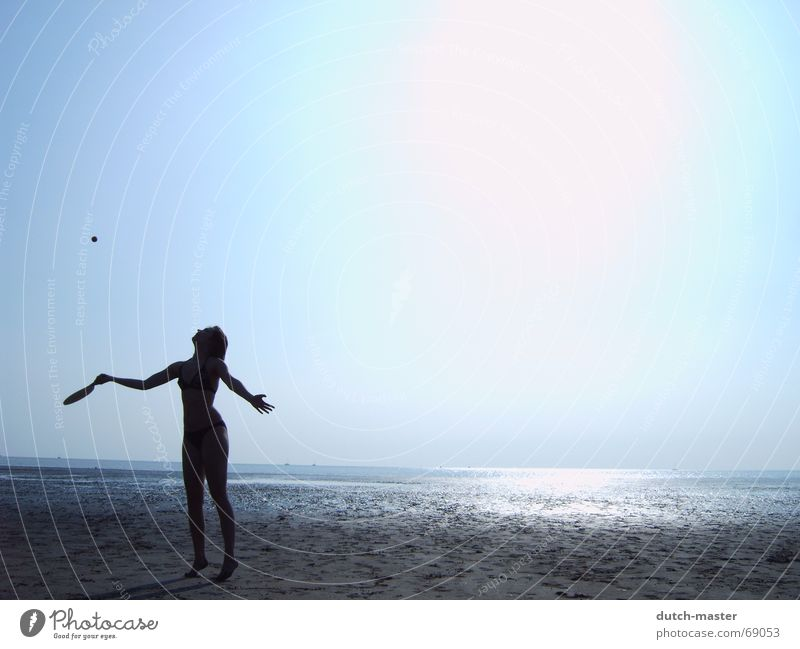 Beach fun #3 Netherlands Summer Slick Woman Light Dark Ocean Vacation & Travel Beach ball Playing Tennis Dazzle Movement Action Visual spectacle Bikini Sun Sand
