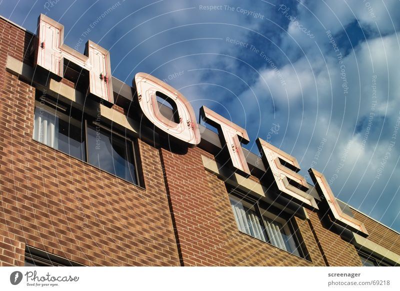 Sky Blue Vacation & Travel Clouds Window Wall (barrier) Facade Characters Letters (alphabet) Advertising Hotel Brick Canada Typography Word