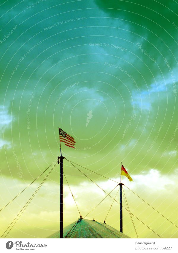 Sky Green Blue Clouds Animal Yellow Germany Grief USA Flag Shows Americas Electricity pylon Wire Clown Cry