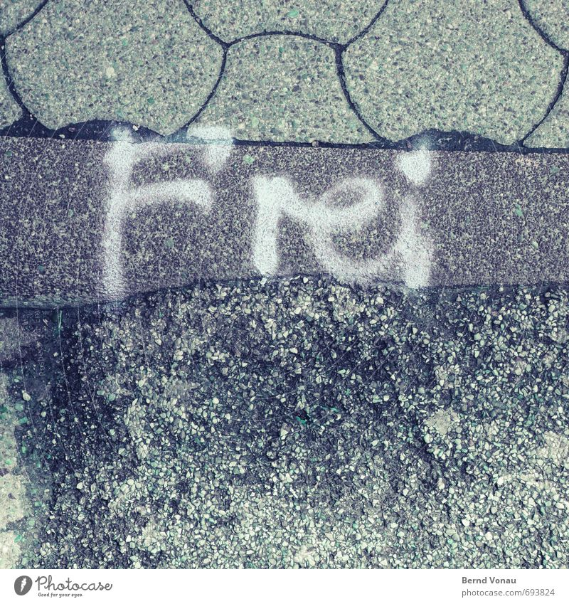 I'll be like this. Street Paving stone Sidewalk Curbside Sign Characters Signs and labeling Graffiti Gray Black White Freedom Fill Reserved Markets Flea market