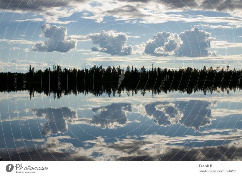 cloud reflection Lake Clouds Bad weather Mirror Mirror image Deception Surface Horizon Calm Equal Symmetry Exterior shot Tree Smoothness Surrealism Sky Division