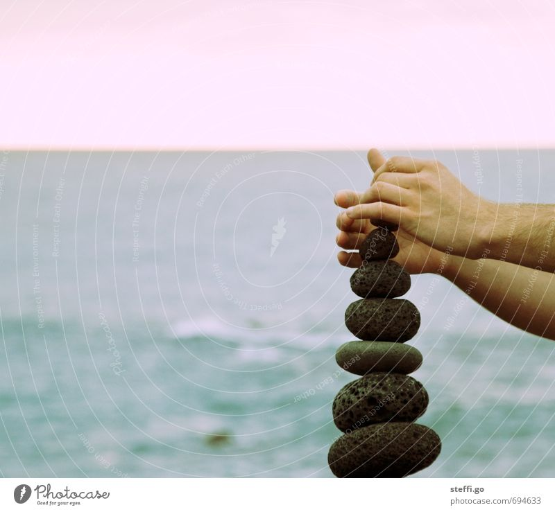 balancing act Contentment Calm Arm Hand Fingers Ocean Build Touch Movement To hold on Exceptional Elegant Optimism Success Power Willpower Brave Determination