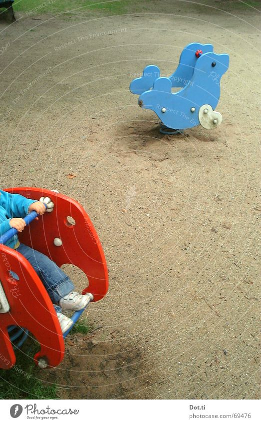 riding through the prairie Playground Seesaw Harbour seal Elephant Footprint Boredom Toys Park Child Toddler Playing To hold on Loneliness Empty Multicoloured