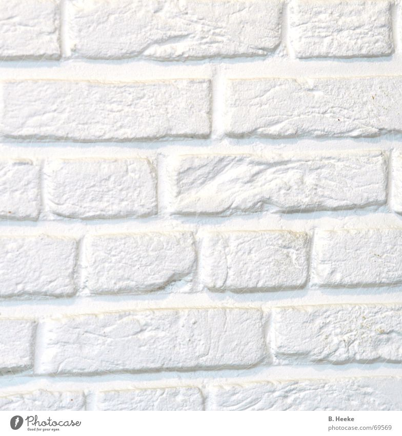 A piece of wall Wall (barrier) White Wall (building) Pattern Bright Stone Detail Structures and shapes